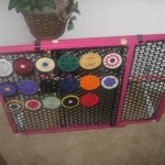 Customized, expandable, portable earring display made from a jazzed-up baby gate