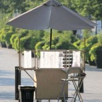 A small, portable outdoor jewelry booth - made from a kitchen cabinet!