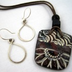 Silver hoops and tribal pendant