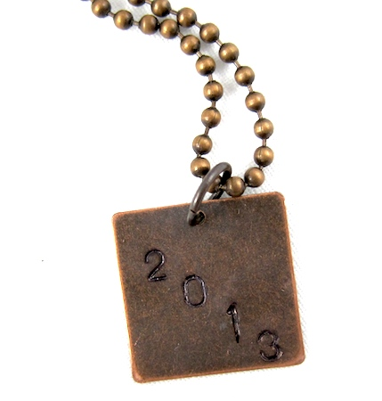 Grungy graduation year necklace by Rena Klingenberg