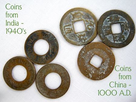 Old coins with holes for jewelry making