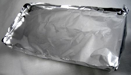 Make an aluminum foil pan with edges