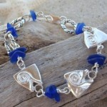 A bracelet with my signature fish head bead and blue sea glass