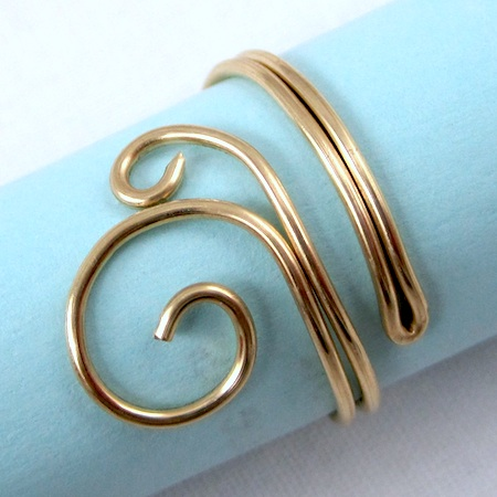 Folded wire copper ring in brass by Rena Klingenberg