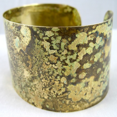 Golden-green brass patina finish