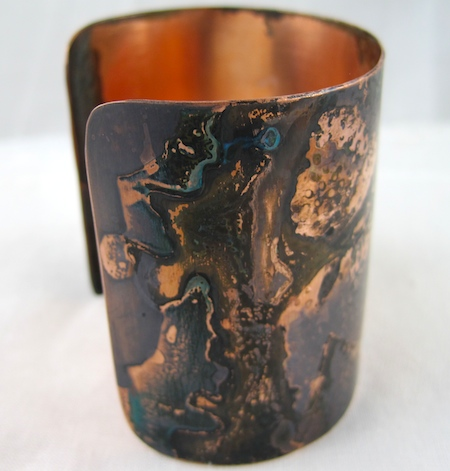 Dark multicolor copper patina finish