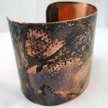 Rustic copper patina almost looks like a painting