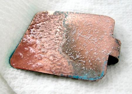 Vinegar and salt patina on copper pendant