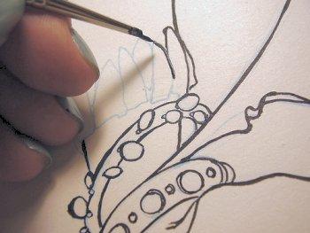 "Carolina Gonzalez using a 3-hair brushto paint her ""Tribal Dancer I"" poster"