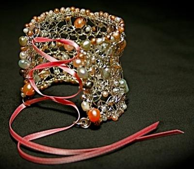Crocheted wire corset-style cuffby Christi Schimpke.