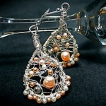 Silver wire and pink pearl earrings by Christi Schimpke.