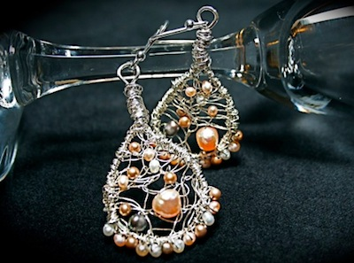 Silver wire and pink pearl earringsby Christi Schimpke.