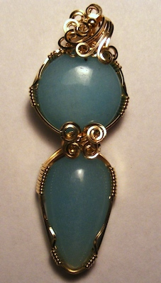 Double blue quartz pendant wrapped in 14k goldfill wire, by Rita Juhlin