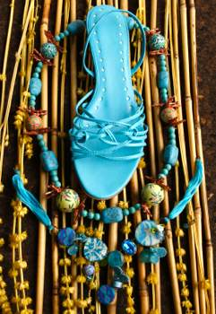 blue sandals and matching beaded necklace