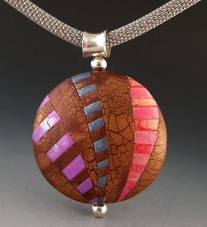 One of Janice's polymer clay pendant beadson her EZ Bead Changer bail