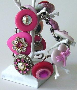 Pink button bracelet.