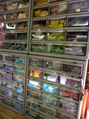 Organizing beads by color in clear plastic drawer units