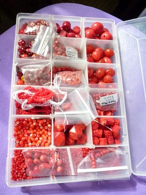Organizing beads by color in semi-transparent compartmented boxes or floss organizers