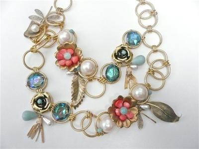 wire-wrapped coral, vintage brass, amazonite in a floral trellis