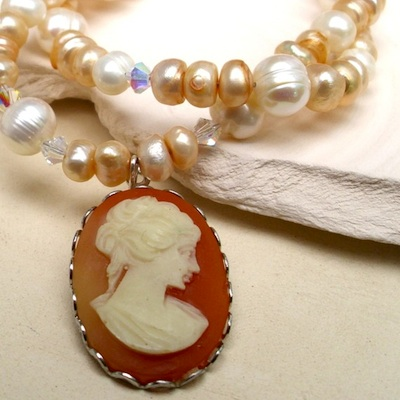 An elegant pearl bracelet? I like to think so. But I call it a classically feminine piece with a delicate peach palette and scintillating crystals. (Bracelet by Chelsea Clarey.)