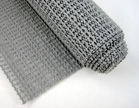Roll of nonskid shelf liner for gripping jewelry tools and components