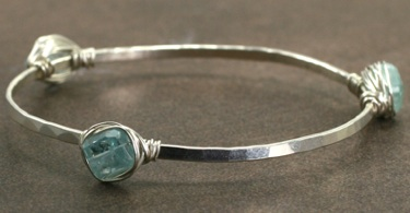 Hammered 3-stone bangle by Judith Bright