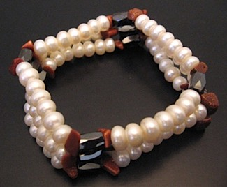 Stacking pearl bracelets held together by magnetic hematite beads (Robert Mayer)