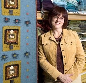 Luann Udell with her big $5,000 wall hanging (from Niche Magazine, April 2006)