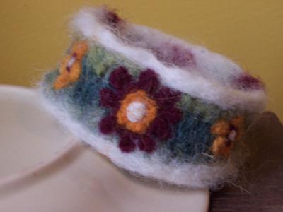 Felted wrist cuff made from a sweater arm