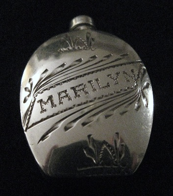 Engraved perfume bottle with cap screwed on