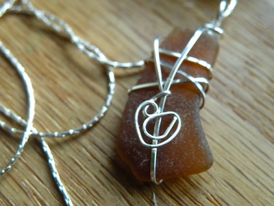 Amber sea glass (Mykonos Island, Greece) with sterling silver.