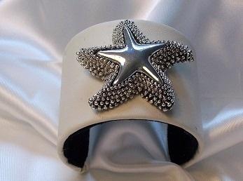 White pleather cuff bracelet with silvertone starfish