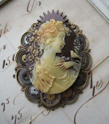 A clever setting of tiny antique gears and wheels distinguishes Violette Noble's Steampunk Cameo Brooch.