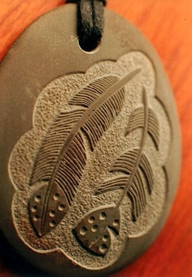 """Two Feathers"" riverstone pendant by Stephen Lee."