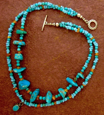 Turquoise, amber, and sterling silver