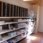 Steel shelves and tray storage for finished jewelry