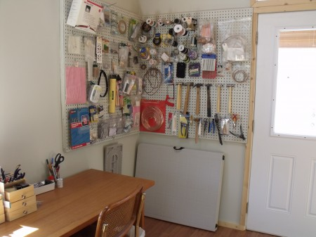 Pegboard for all that hard to store wire and tools and my beading desk