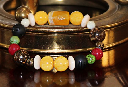 Five Elements Jewelry. Seen Here: Metal Element barcelet-Influential color: Gold/Yellow