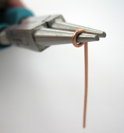 Making hook clasp for leather choker - by Rena Klingenberg
