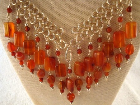 Carnelian necklace with handmade silver wire detail.