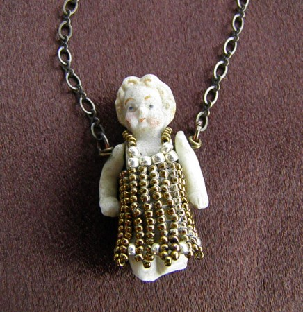 Porcelain doll 'relic' necklace by Sandy Kane