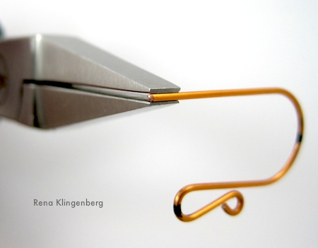 Bending earwire for Easy Fancy Earwires Tutorial by Rena Klingenberg