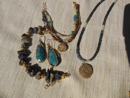 Bronze charms on gemstone necklaces