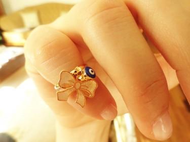 Bowtie knuckle ring by Handemadeit