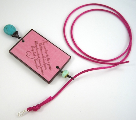 Stringing the cord through the pendant bail on Colorful Reversible Necklaces - tutorial by Rena Klingenberg