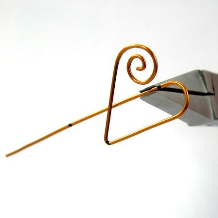 Bending the wire upward for Heart Earwires - tutorial by Rena Klingenberg