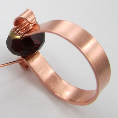 Finished wire around one scroll for Scroll Ring with Spinner Bead - tutorial by Rena Klingenberg