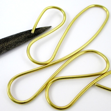 Filing wire end for Dangerous Curves Wire & Chain Necklace - tutorial by Rena Klingenberg