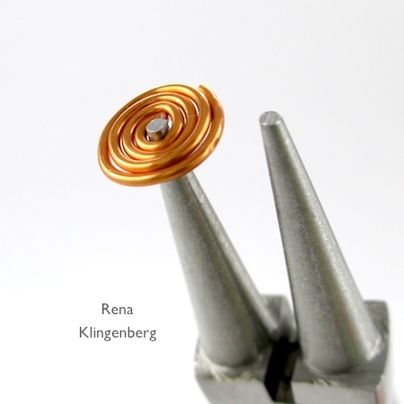 Turning spiral into a cone for Spiral Wire Bead Cap - tutorial by Rena Klingenberg