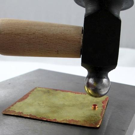 Hammer-flattening the eyelet rivet for Easy Riveted Pendant - tutorial by Rena Klingenberg